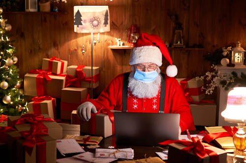 Santa wrapping gifts with PPE