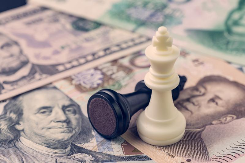US and China finance trade war concept_ black loser and white winner chess king on US dollar and china yuan banknotes_ world major market countries.