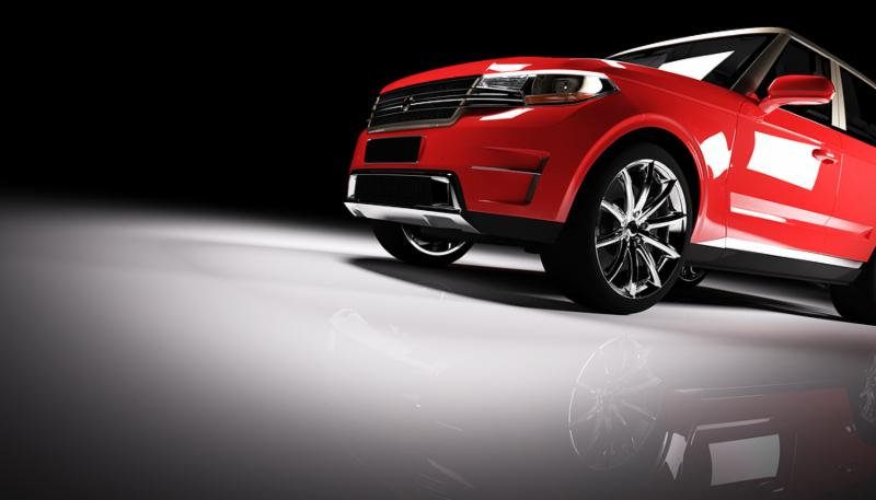 Modern red SUV car in a spotlight on a black background. Front view. 3D illustration. Luxury cars.