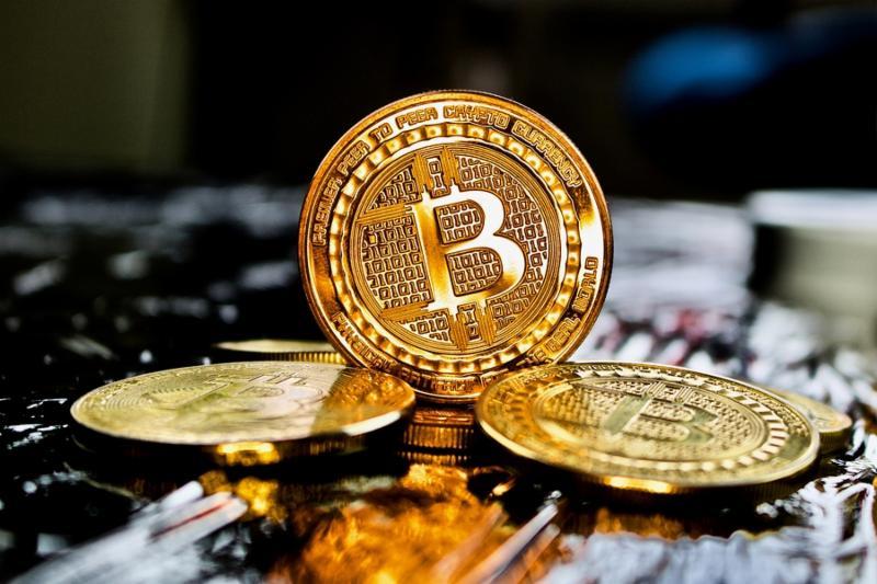 Cryptocurrency physical gold bitcoin coin near bitcoins