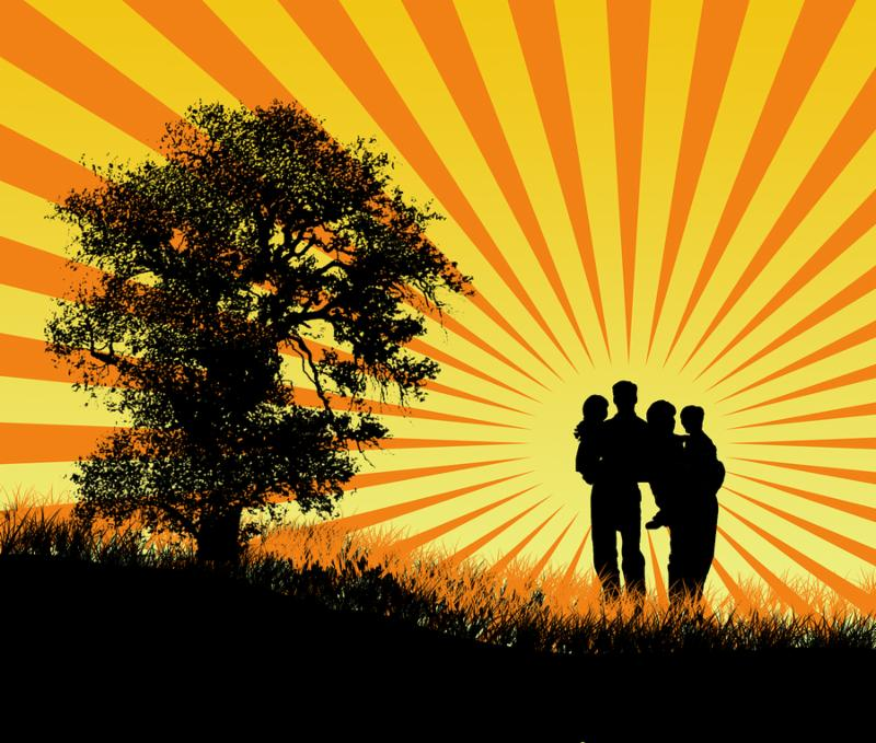 happy family at sunset with tree and grass