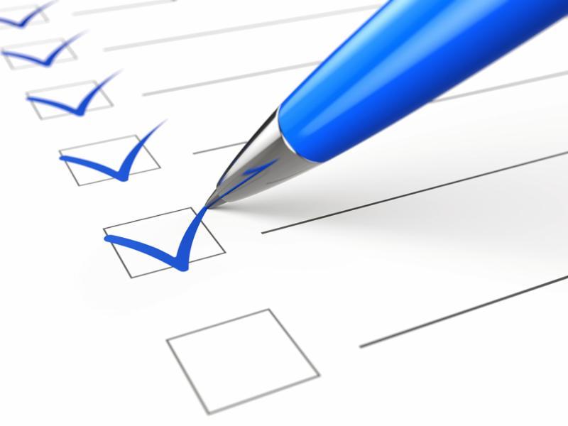 Checklist concept - checklist, paper and pen