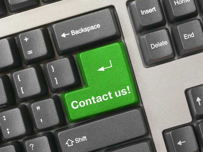 Keyboard - green key Contact us business background