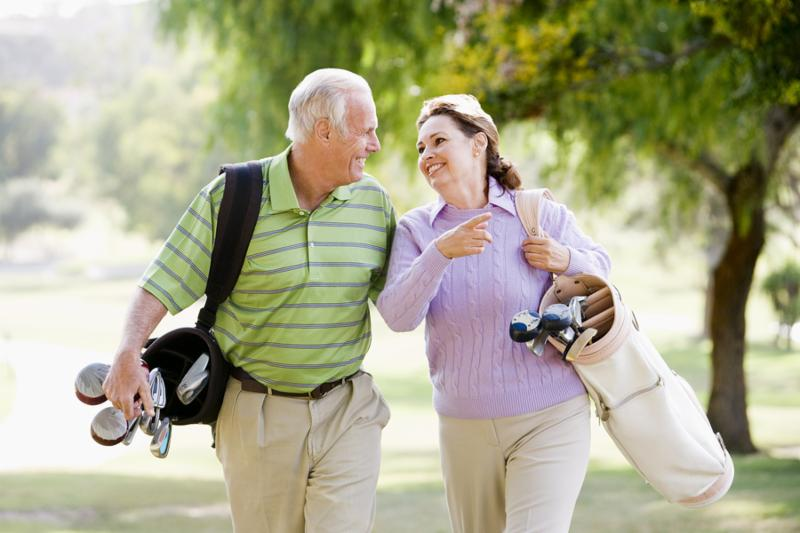 Couple Enjoying A Game Of Golf