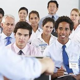 group of people in audience at training