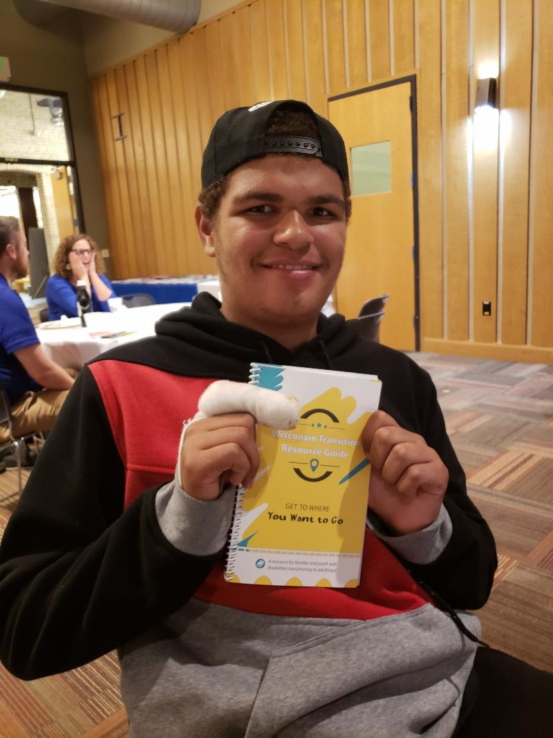 Promise youth holding the Transition Guide
