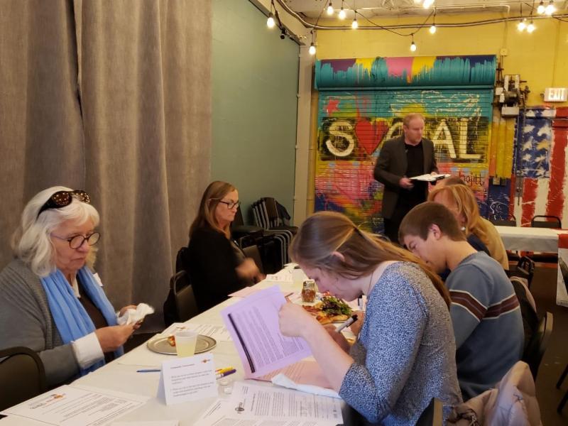 participants reading handouts