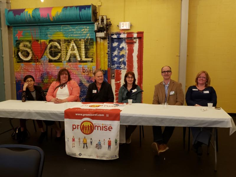 Wisconsin promise panel sitting at a table
