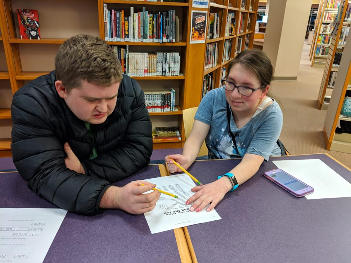 Teens working together at the library