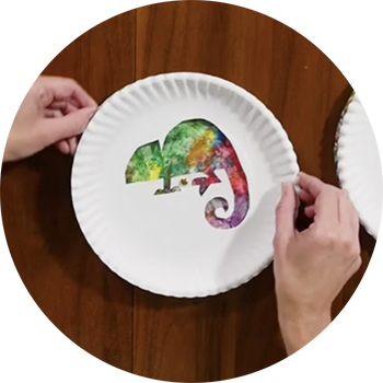 Photo of a chameleon craft made with paper plates and paint.
