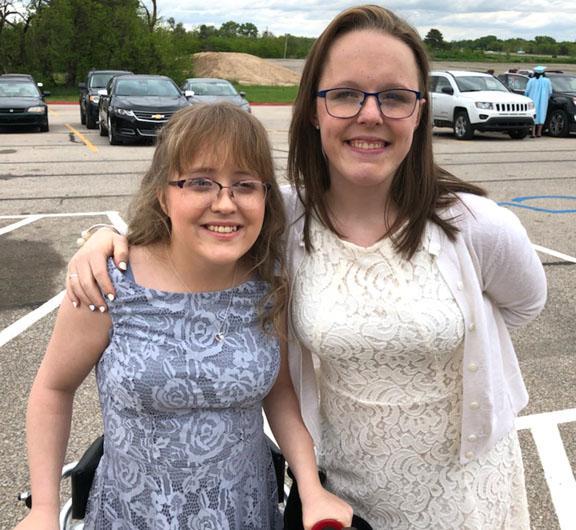 Jocelyne and Elizabeth dressed up for a picture with Jocelyne's arm around Elizabeth