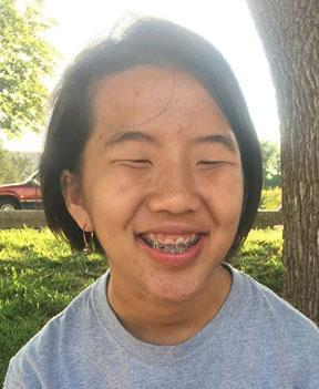 Ashlee Thao smiling outside