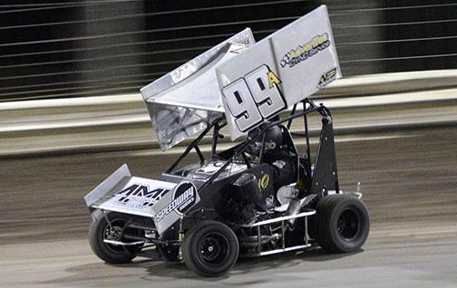 A black and gray race car with the number 99 driven by Alex Owen