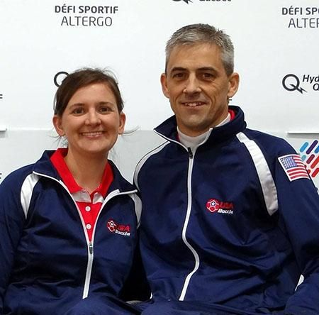 Adam Burnett and his wife Beth at a competition wearing their USA gear