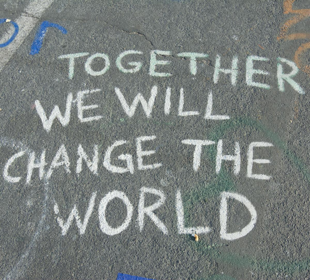 Chalk drawing that says Together We Will Change the World