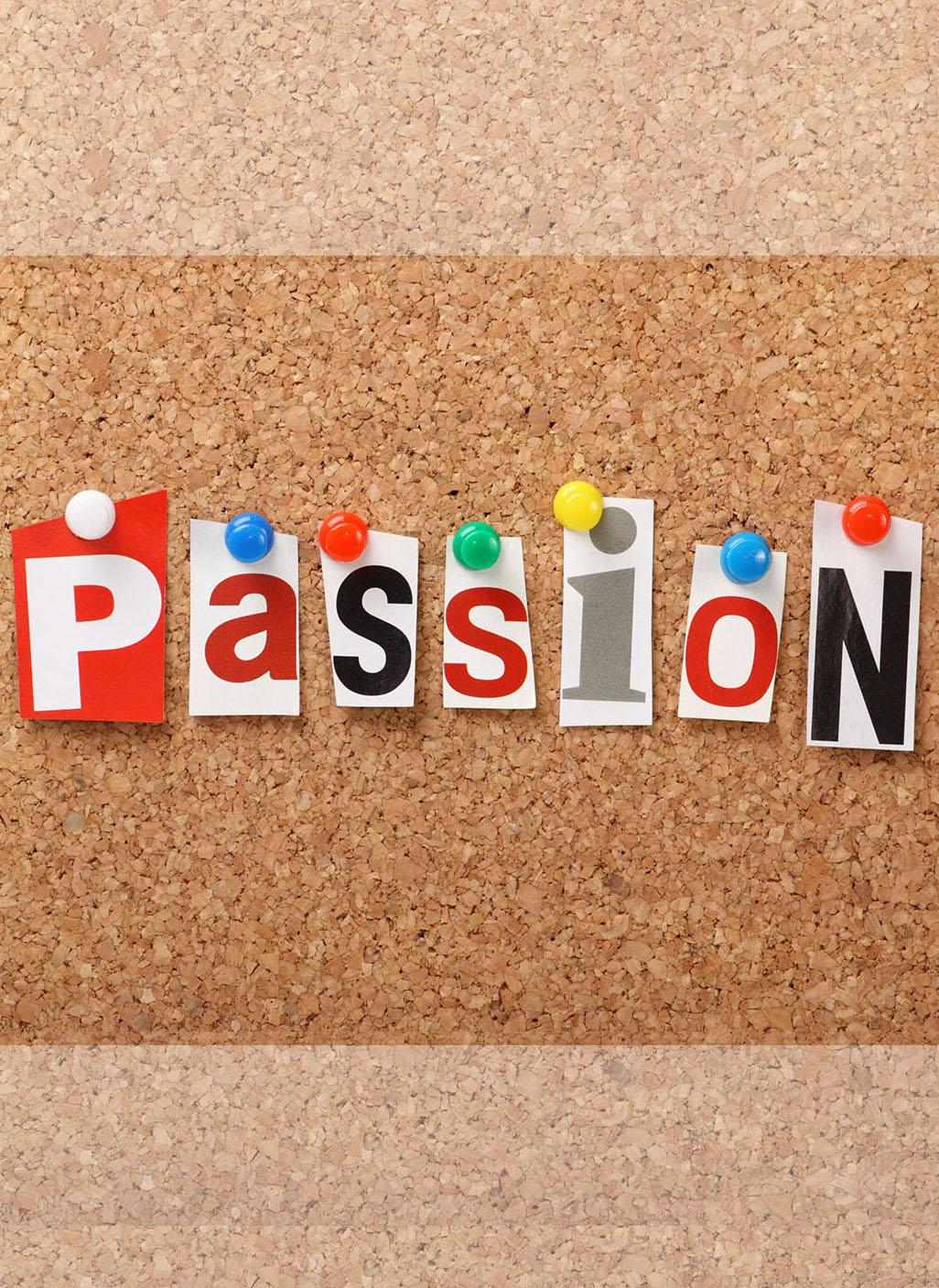 Passion on a corkboard with each individual letter cut out of a magazine