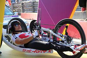 A female in a handcycle at an Olympic games