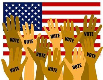 Various hands in the air that say vote with diverse skin colors and a flag in the background