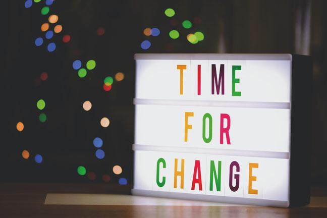 A lit up colorful sign that says Time for Change