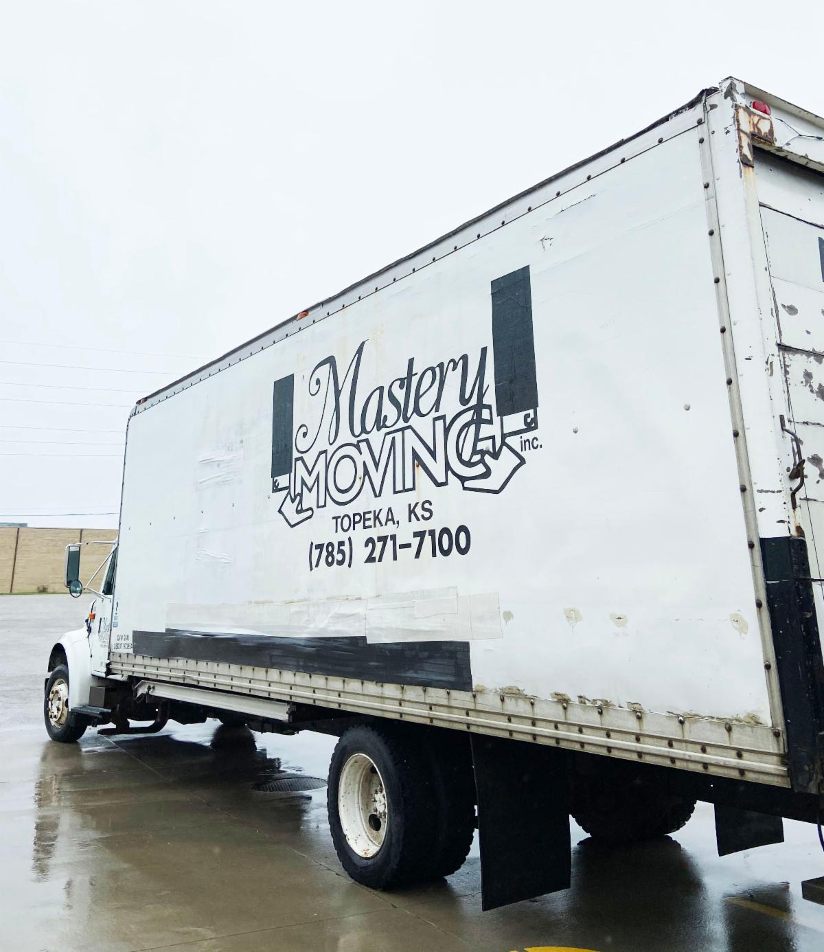 A moving van outside from Mastery Movers