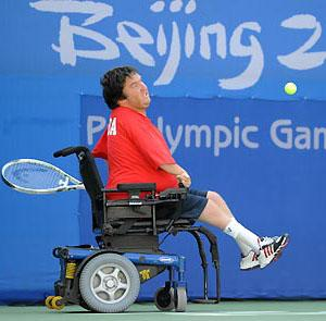 Nick Taylor- An adult male who is a wheelchair user hits the ball in a tennis game