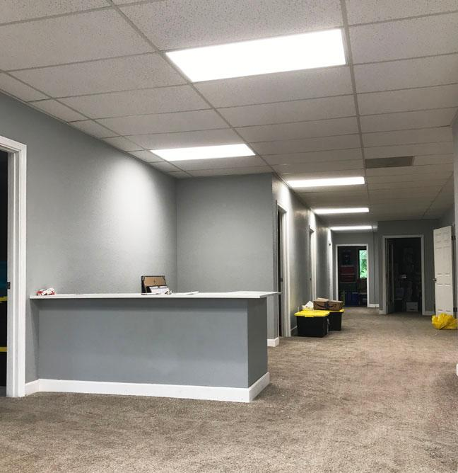 A view inside our new office from the front door with a front desk and gray walls
