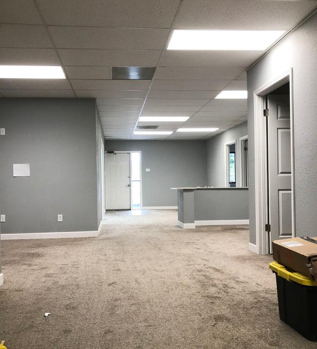 Another view of our new office in the hallway with lots of offices and gray walls