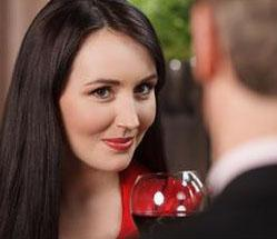 A woman looking flirtatiously at her date