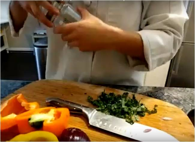 Instructor cooking at home, chopping veggies