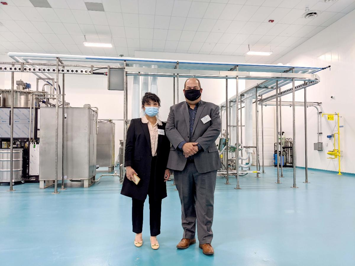 Dr. Jacqueline Shan and Robb Stoddard pose for a photo at the official opening of the PBG BioPharma Leduc Facility.