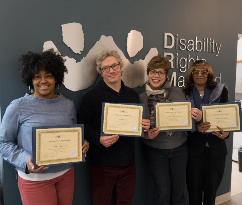 from left to right: Tacha Marshall displays her 30 year recognition certificate, Hal Malone displays his five-year certificate, Pamela Foresman showing her five-year certificate and Jacqueline Phillips shows her 20 year-certificate.