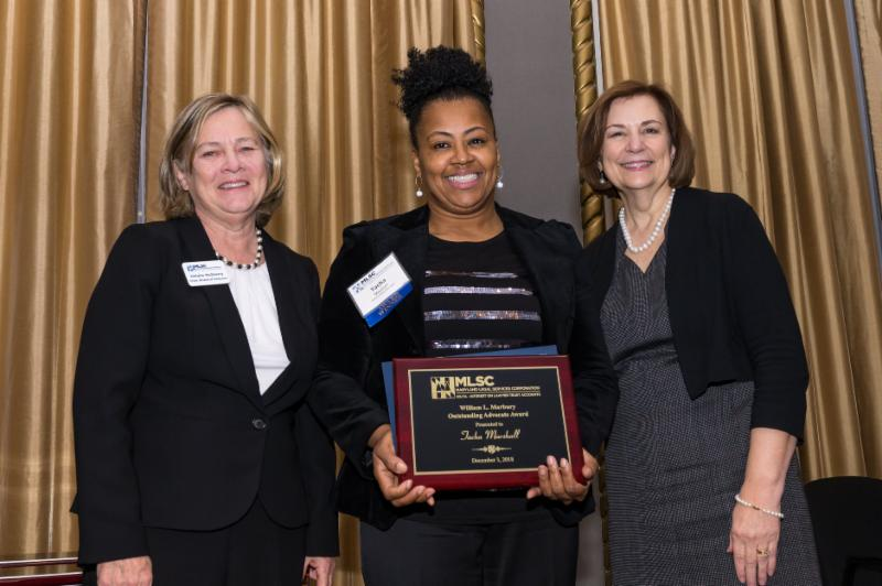 Tacha Marshall (Center) receives William L. Marbury Outstanding Advocate MLSC Award. Photo credit: Maryland Legal Services Corporation; Guill Photo, Inc.