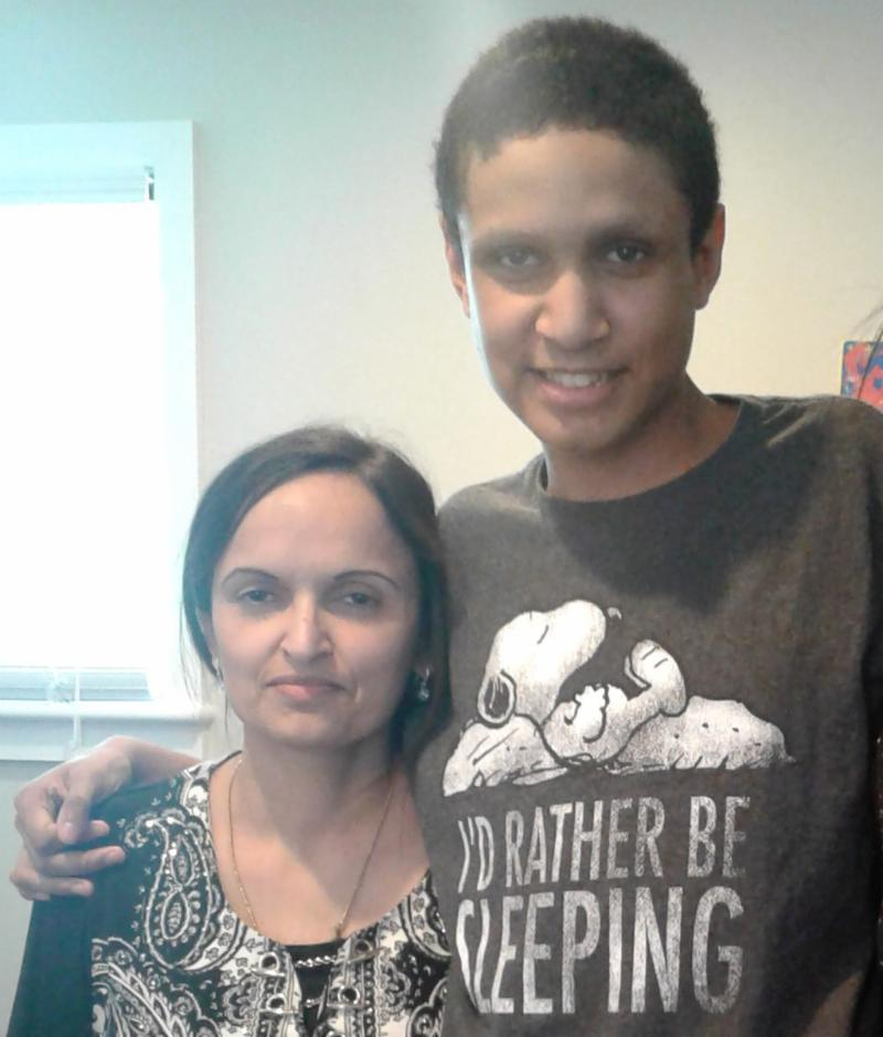 Client SM (right) and his mother