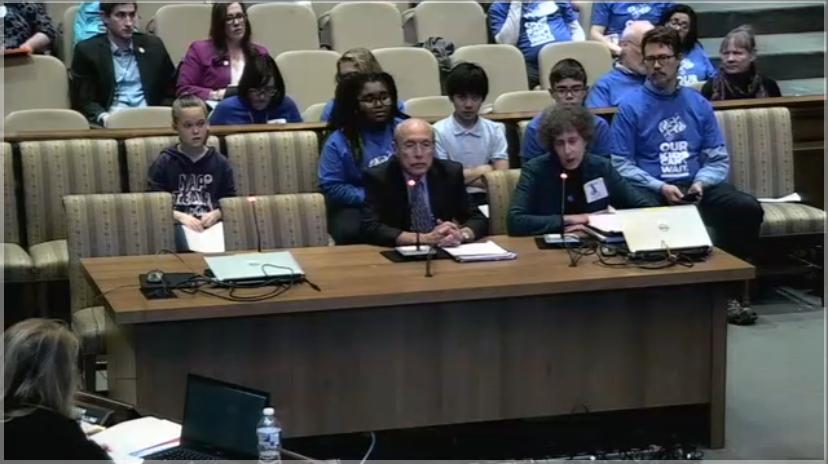 Screenshot of Leslie Margolis, DRM Managing Attorney, sitting at desk speaking into mic.