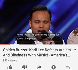 Kodi Lee performing with headline_ _Kodi Lee defeats autism and blindness with music_