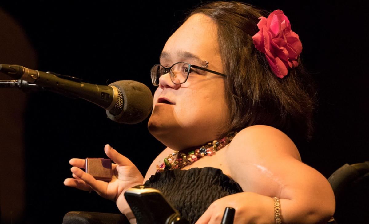 Gaelynn Lea at a microphone
