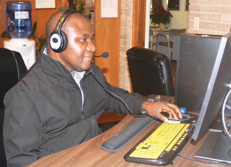 man at computer with headset on