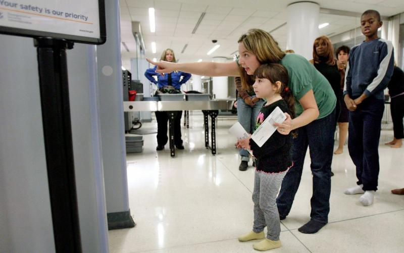a woman and child in an airport