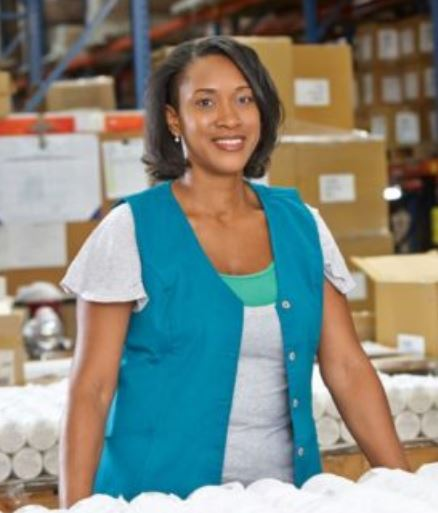 woman in a uniform in a warehouse