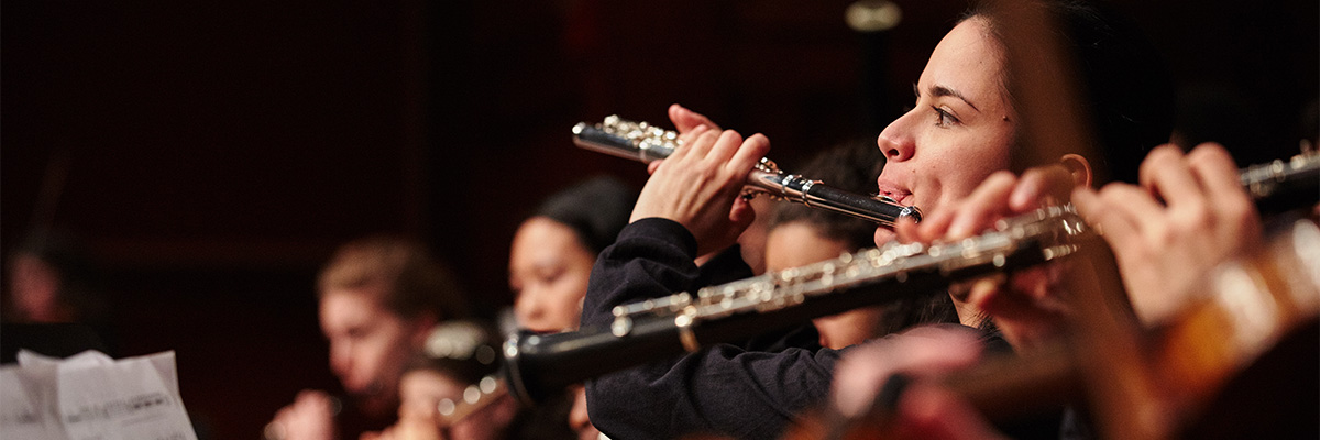 Flutists playing in orchestra