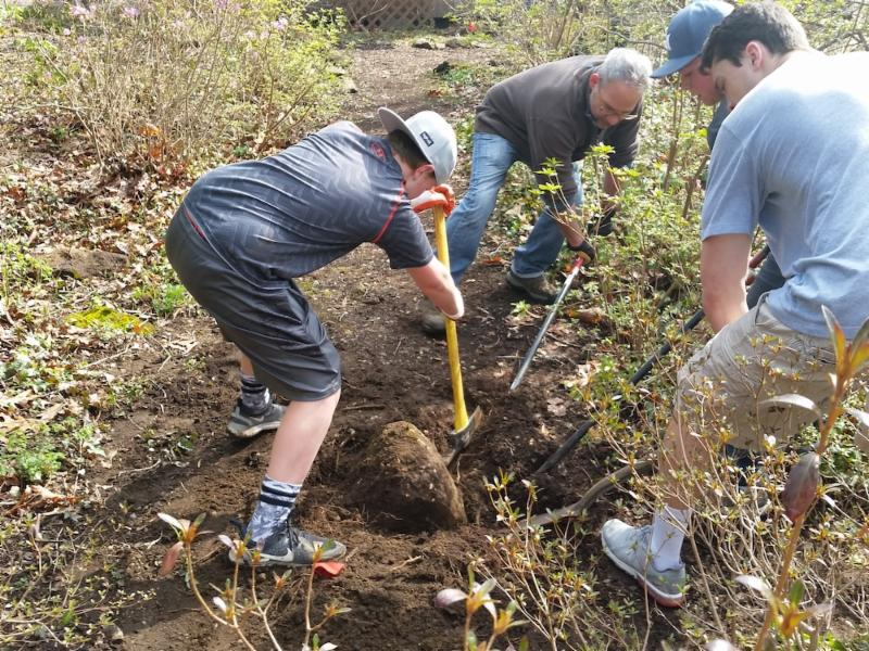 Eagle Scouts removing rock