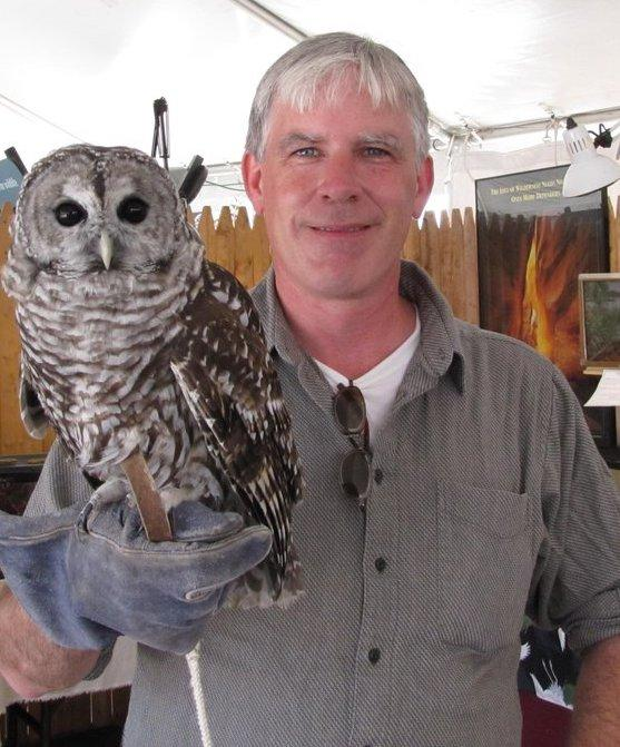 Patrick Comins with Owl