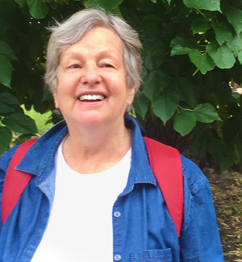 A photo of Ingeborg Kohler, a white older woman with short grey hair, smiling at the camera, outside.