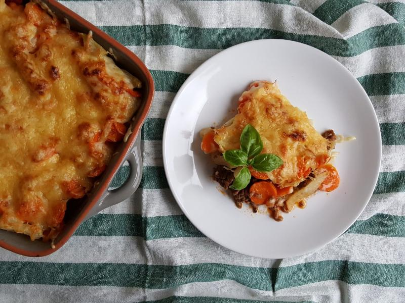 Casserole dish and food on plate