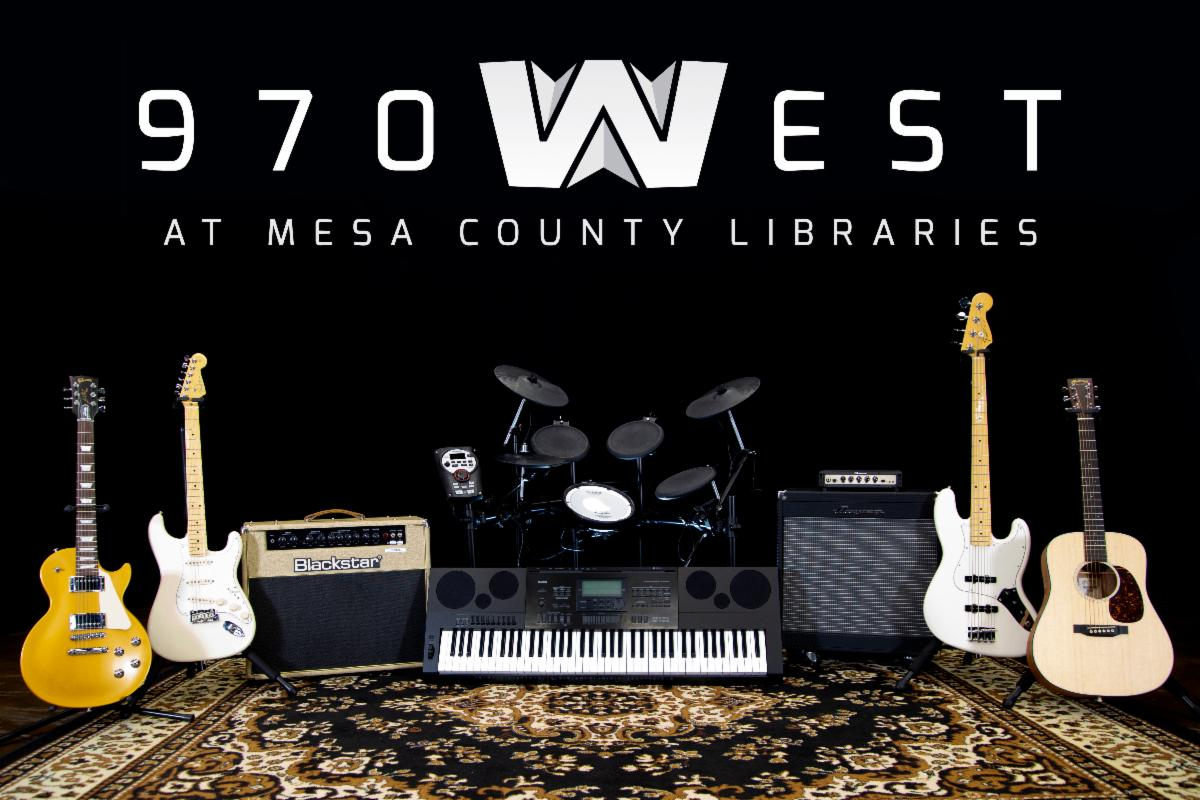 Photograph of guitars, amps, keyboard, and other musical instruments from 970West Studio