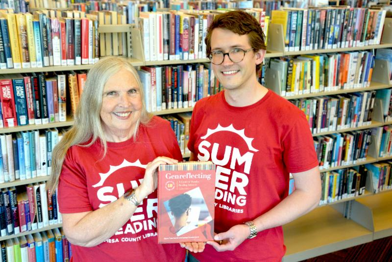 Librarians and authors Di Herald and Sam Stavole-Carter show their book, Genreflecting.