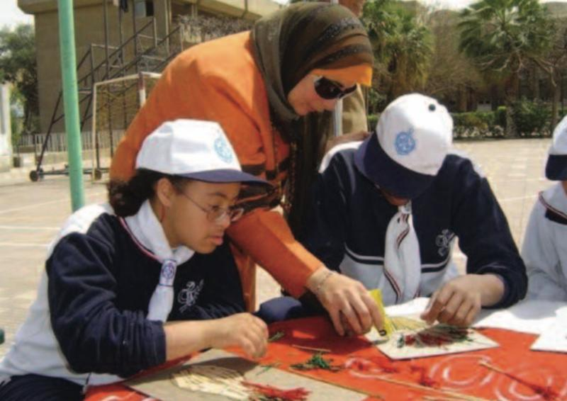 Woman teaching refugee students with intellectual disabilities.