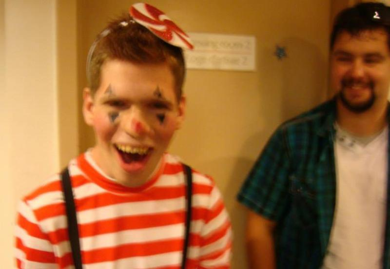 Brock Welton smiling at the camera in a costume.