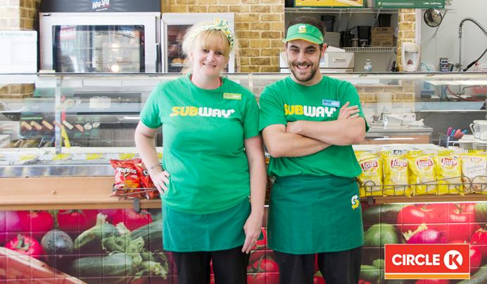 Two employees from CircleK Subway smiling.