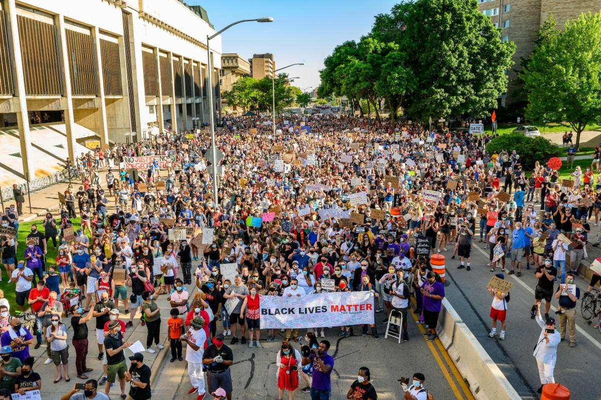 Hundreds of demonstrators from the community gather and speak out against racism and racial injustice as they they walk north on North Park Street towards Library Mall at the University of Wisconsin-Madison for a Black Lives Matter Solidarity March on June